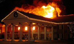 Arsonist Fire Threatens Hotel Business Thumbnail Image